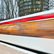 Train leaves the station early morning - Stock Photo
