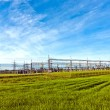 Transformer station under blue sky in landscape - Stock Photo