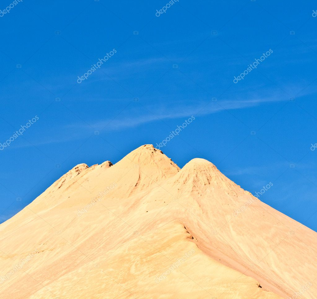 Hills of sand and stone of a mine gives an impression of mountains — Stock Photo #6743767