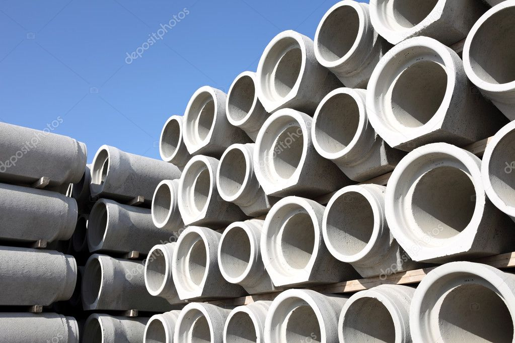 Concrete water pipes stacked in rows — Stock Photo #5489893