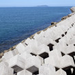 图库照片: Breakwater with concrete blocks