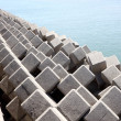 Breakwater with concrete blocks - Foto Stock