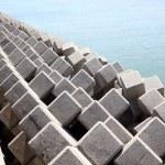 Breakwater with concrete blocks — Stock Photo