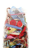 Ribbons articles put in bottle — Stock Photo