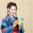 Japanese woman in traditional clothes of Kimono - Stock Photo