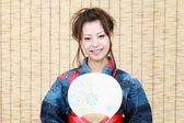 Young japanese woman in traditional clothes of kimono — Stock Photo