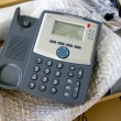 New VoIP phone in package - Stock Photo