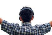 Chico con auriculares aislados en blanco — Foto de Stock