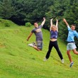 Happy youngsters jumping — Stock Photo