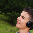 Teenager with headphones — Stock Photo