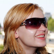 Stock Photo: Beautiful young woman with sunglasses