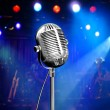 Music background with vintage microphone and concert — Stock Photo