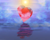 Heart reflection on sunset foggy sky — Stock Photo