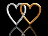 Golden heart rings intersecting — Stock Photo