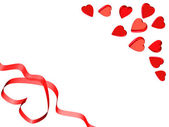 Valentine card,heart ribbon and red hearts — Stock Photo
