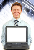 Young businessman presenting a laptop — Stockfoto