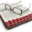 Open Bible with Glasses - Stok fotoğraf