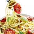 Pesto and Tomato Spaghetti - Stock Photo