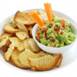 Guacamole with Bagel Crisps - Stock Photo