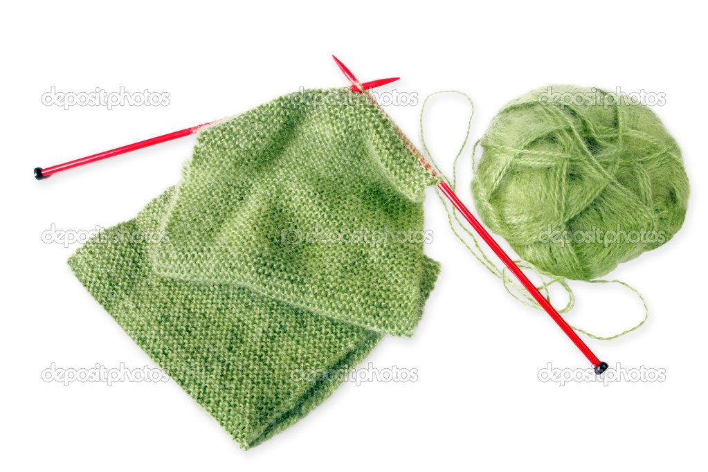 Knitting a green fluffy woollen scarf, with red knitting needles.  Isolated on white with shadow.  Stock Photo #5526297