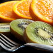 Stock Photo: Sliced Orange and Kiwi Fruit