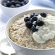 Постер, плакат: Oatmeal with Blueberries and Yoghurt