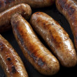 Cooking Sausages - Stock Photo