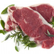 Stock Photo: Raw Steaks with Herbs