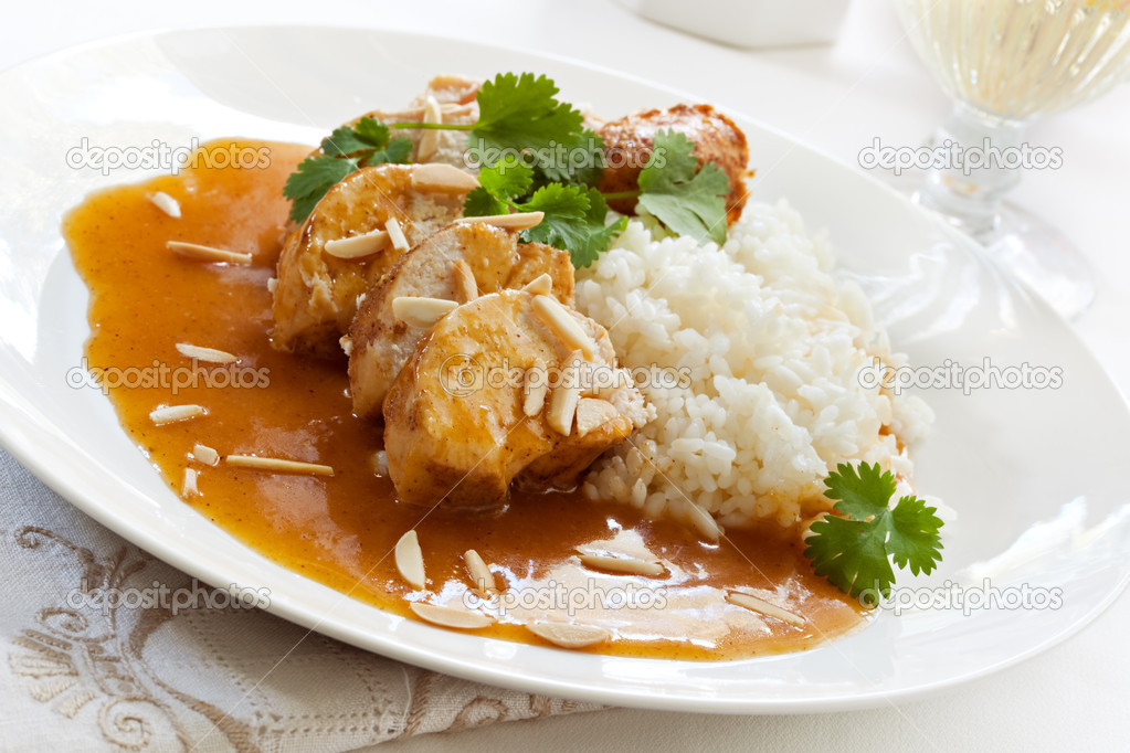 Slow-cooked apricot chicken, with rice, cilantro and toasted almonds.   — Stock Photo #5530565
