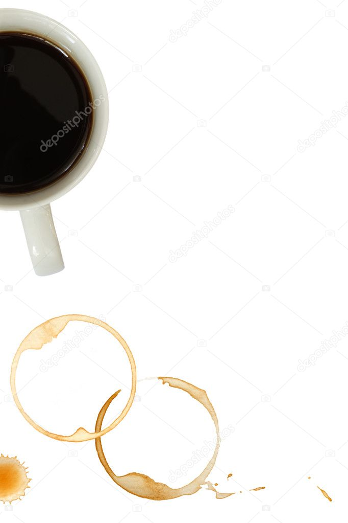 Coffee mug with stains and splashes over white background.  Stock Photo #5531466