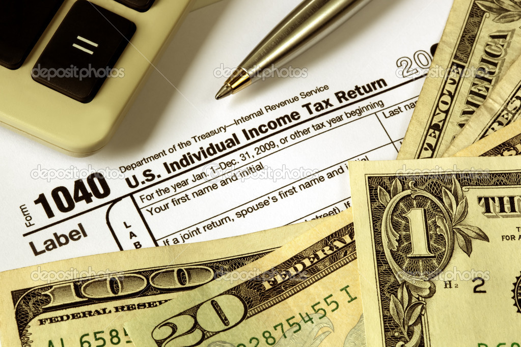 Tax refund - money over 1040 Tax form, with calculator and pen. — Stock Photo #5531582