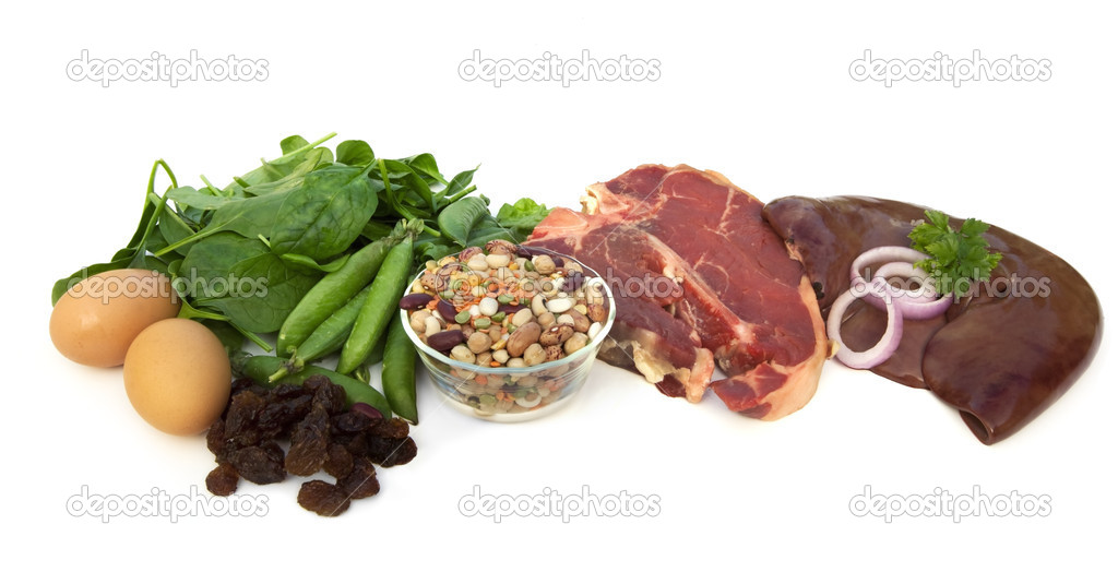 Iron-rich foods, including eggs, spinach, peas, beans, red meat, liver, and raisins.  Isolated on white. — Stock Photo #5623821