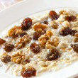 Постер, плакат: Oatmeal with Raisins and Walnuts