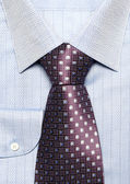 Dark blue man's shirt with a violet tie — Stock Photo