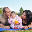 Happy family outdoors on grass — Stock Photo #5643891