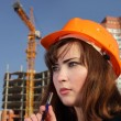 Beauty architect woman on build area - Stock Photo