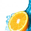 Fresh lemon dropped into water — Stock Photo