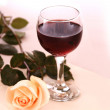 Wineglass and rose - Stock Photo