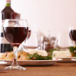 Glasses of red wine and dinner — Stock Photo