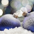 Christmas balls in snow — Stock Photo