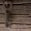 Old key on wood deck — Stock Photo