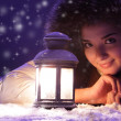 Beautiful girl on winter snow with lantern — Stock Photo #5645478