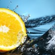 Orange in water — Stock Photo