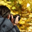 Man taking a photograph — Stock Photo