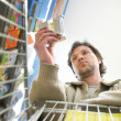 Man shopping, view from cart — Stock Photo