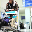 Man with baggage waiting at the airport — Stock Photo