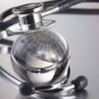 Stock Photo: Stethoscope on globe