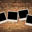 Empty blank photos on old brick wall - Stock Photo