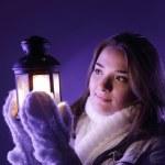 Beautiful girl on winter snow with lantern — Stock Photo