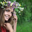 Girl in a flower wreath — Stock Photo